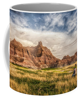 Coffee Mug featuring the photograph Photographer Waiting For The Badlands Light by Rikk Flohr