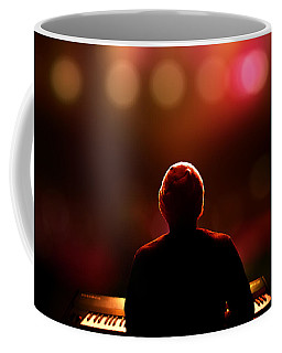 Pianist On Stage From Behind Coffee Mug