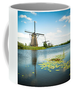 Coffee Mug featuring the photograph Picturesque Kinderdijk by Hannes Cmarits
