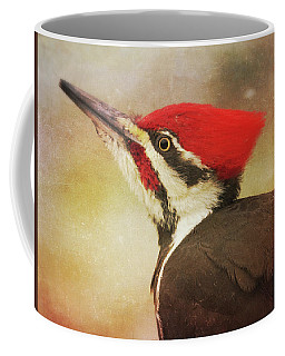 Coffee Mug featuring the photograph Pileated Woodpecker With Snowfall by Heidi Hermes