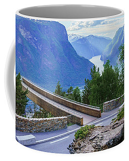 Coffee Mug featuring the photograph Pine On Stegastein by Dmytro Korol