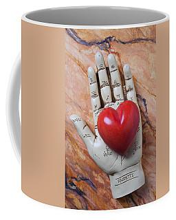 Plam Reader Hand Holding Red Stone Heart Coffee Mug