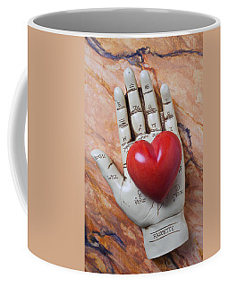 Plam Reader Hand Holding Red Stone Heart Coffee Mug
