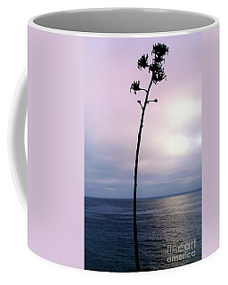 Coffee Mug featuring the photograph Plant Silhouette Over Ocean by Mariola Bitner