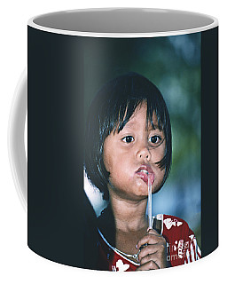 Coffee Mug featuring the photograph Playful Little Girl In Thailand by Heiko Koehrer-Wagner