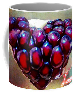 Coffee Mug featuring the digital art Pomegranate Heart by Genevieve Esson