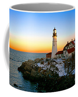 Coffee Mug featuring the photograph Portland Head Light Winter Sunset by Olivier Le Queinec