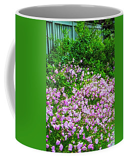 Posies By The Fence Coffee Mug by Nancy Marie Ricketts
