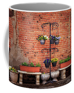 Coffee Mug featuring the photograph Potted Plants And A Brick Wall by James Eddy