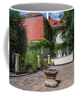 Coffee Mug featuring the photograph Prague Courtyards by Jenny Rainbow
