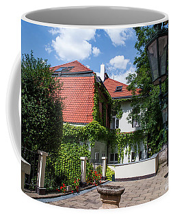 Coffee Mug featuring the photograph Prague Courtyards. Old Lantern by Jenny Rainbow
