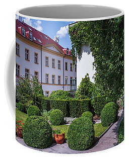 Coffee Mug featuring the photograph Prague Courtyards. Regular Style Garden by Jenny Rainbow