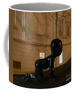 Prague's Faceless Baby Statue Coffee Mug