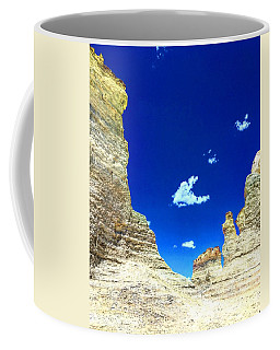 Pristine Sky Meets Historic Rocks Coffee Mug