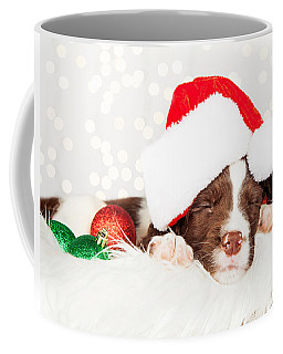 Puppy Wearing Santa Hat While Napping On Fur At Home Coffee Mug