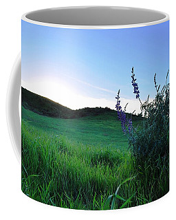 Coffee Mug featuring the photograph Purple Wildflowers In Beautiful Green Pastures by Matt Harang