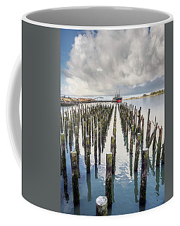 Coffee Mug featuring the photograph Pylons To The Ship by Greg Nyquist