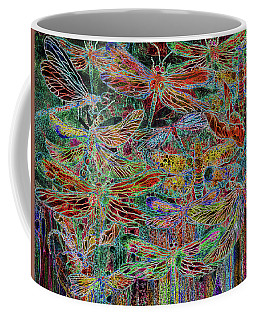 Coffee Mug featuring the mixed media Rainbow Dragonflies by Carol Cavalaris