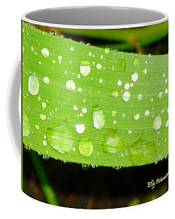 Coffee Mug featuring the pyrography Raindrops On Leaf by Elly Potamianos