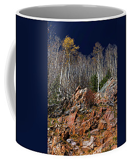 Reaching Into Blue Coffee Mug