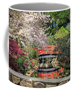 Coffee Mug featuring the photograph Red Bridge Spring Reflection by James Eddy