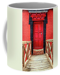Coffee Mug featuring the photograph Red Door At A Monastery by Alexey Stiop