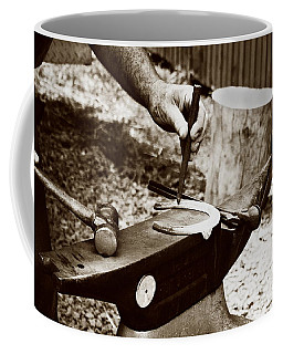 Coffee Mug featuring the photograph Red Hot Horseshoe On Anvil by Angela Rath