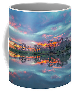 Reflection At Sunrise Coffee Mug by Marc Crumpler