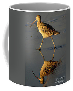 Reflection Of A Curlew At Low Tide Coffee Mug by Debby Pueschel