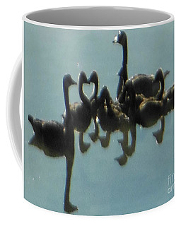 Coffee Mug featuring the photograph Reflection Of Geese by Rockin Docks Deluxephotos