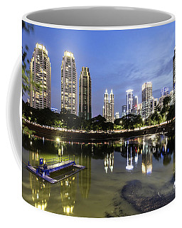 Reflection Of Jakarta Business District Skyline During Blue Hour Coffee Mug