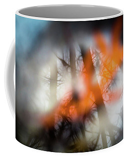 Reflection Of Trees Over An Oak Leaf Encased In Water And Ice Coffee Mug