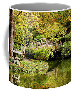Coffee Mug featuring the photograph Reflections In The Japanese Garden by Iris Greenwell
