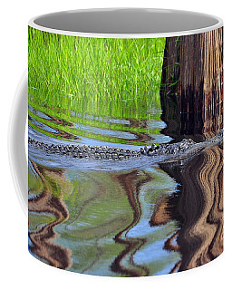 Coffee Mug featuring the photograph Reptile Ripples by Al Powell Photography USA