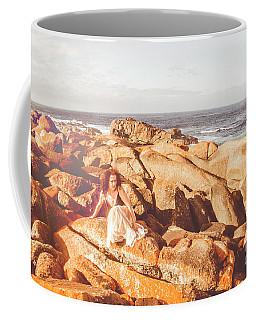 Resting On A Cliff Near The Ocean Coffee Mug
