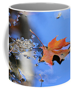 Coffee Mug featuring the photograph Resting On Gold And Blue by Doris Potter