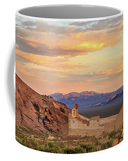 Coffee Mug featuring the photograph Rhyolite Bank At Sunset by James Eddy