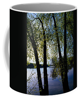Riverview Through Budding Trees Coffee Mug