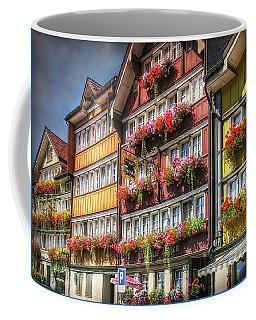 Coffee Mug featuring the photograph Row Of Swiss Houses by Hanny Heim