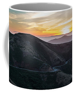 Road On The Edge Of The Mountain With Sunrise In The Background Coffee Mug