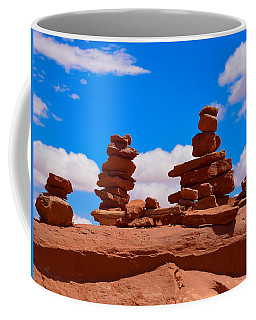 Coffee Mug featuring the photograph Rock Cairns In The Desert by Dany Lison