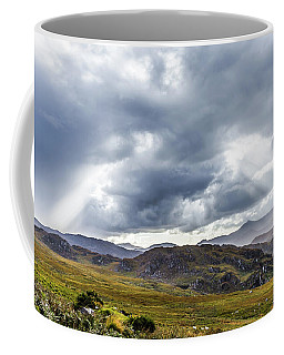 Coffee Mug featuring the photograph Rock Formation Landscape With Clouds And Sun Rays In Ireland by Semmick Photo
