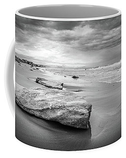 Rocks On A Sandy Beach. Coffee Mug