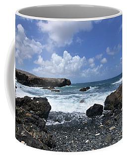 Rocks Scattered Across Aruba's Black Sand Stone Beach Coffee Mug