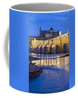 Roman Bridge On Guadalquivir River At Dawn Coffee Mug