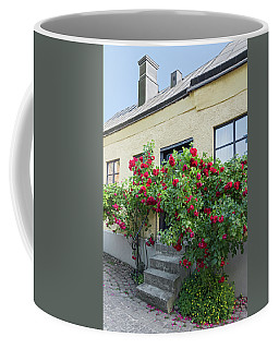 Roses Growing Near The House In A Swedish Town Visby Coffee Mug