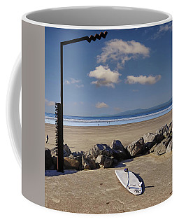 Rossnowlagh Beach On The Wild Atlantic Way With A Surfboard And Rocks Coffee Mug