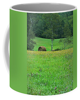 Coffee Mug featuring the photograph Round Bale And Wildflowers by Joy Nichols