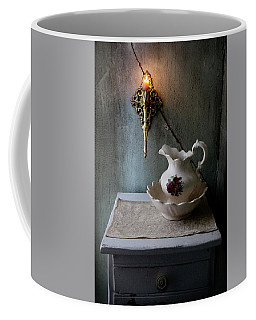 Rustic Water Closet With Brass Sconce And A Pretty Floral Patter Coffee Mug
