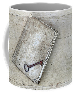 Coffee Mug featuring the photograph Rusty Key On The Old Tattered Book by Michal Boubin